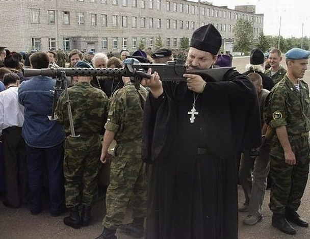 2389-priest-with-gun