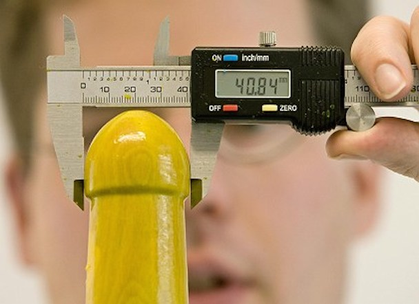 Jan Vinzenz Krause of the Institute for Condom Consultancy measures a prototype of a spray-on condom, in Singen, Germany
