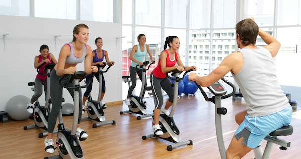 stock-footage-spinning-class-in-fitness-studio-led-by-energetic-instructor-at-the-gym