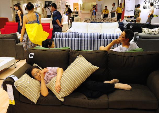 An elderly Chinese (bottom) women rests