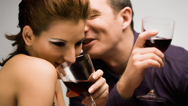 couple-flirting-while-drinking-wine