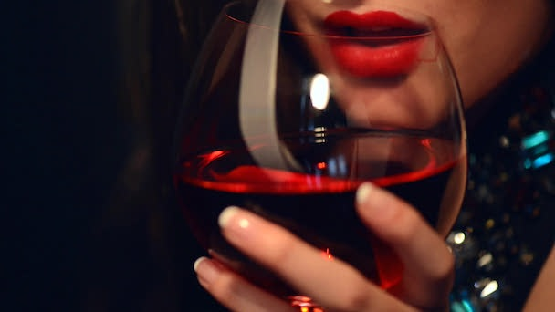 stock-footage-beautiful-young-woman-drinking-red-wine-close-up-video-footage-of-beauty-lady-with-glass-of-wine