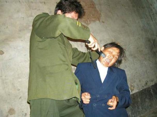 torture_christian_elder_china_1141339424