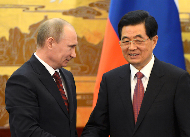 China's President Hu and Russian President Putin shake hands during a signing ceremony in Beijing
