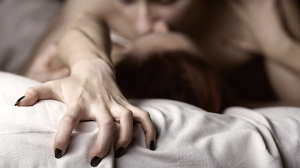 Young-couple-making-love-in-bed.-Focus-on-hand-via-Shutterstock-615x345