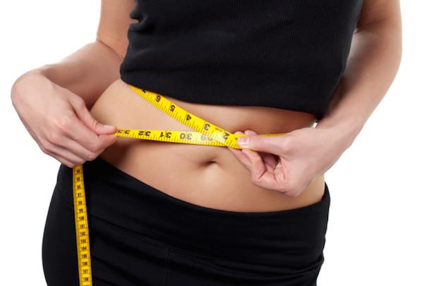 woman_measuring_her_waist_line