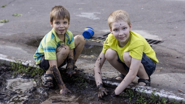 two_boys_playing_in_dirt