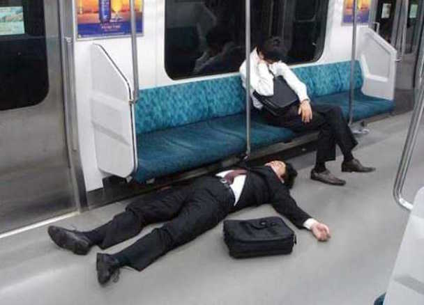 if-you-are-drunk-japanese-businessmen-you-can-sleep-anywhere-77154