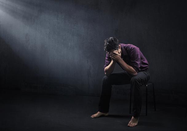 bigstock-Sad-man-in-a-empty-room-12127298